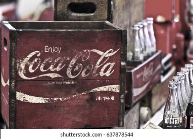 MALAYSIA, KUALA LUMPUR 08 MEI 2017: Motion Blur. Vintage tone. Depth of field. Selected Focus. A collection of old and vintage coca cola bottles with rack.