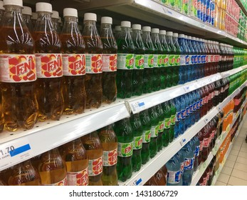 Malaysia, Kuala Lumpur - 21 JUNE 2019 : F & N carbonated drinks with various flavors and colors are placed on a shelf in a supermarket.