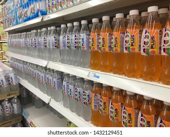 Malaysia, Kuala Lumpur - 21 JUNE 2019 :100 plus is arranged on a shelf in a supermarket. 100 plus is a sponsor for sports in malaysia and is the choice of sportsmen in the country.