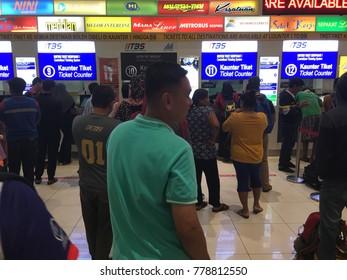 Malaysia, Kuala Lumpur - Desember 18, 2017 : people are in the waiting queue dealing ticket counters at the bus terminal (Terminal Bersepadu Selatan - TBS).