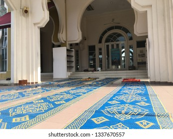 Malaysia, Kuala Lumpur - March 11 2019 : Muslim Plastic mats are arranged in a row outside the mosque.
