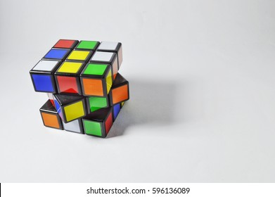 Malaysia, Marc 5 2017,  colourful Rubik's cubes on white background. Solving difficult IQ quiz tasks.selective focus.