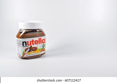 Malaysia- March 23,2017 : Closeup Nutella on white background. Nutella is widely popular brand name of a sweetened hazelnut cocoa spread. Selective focus.