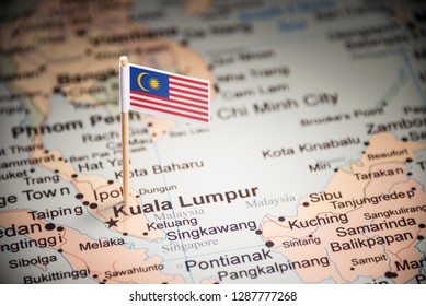 Malaysia marked with a flag on the map