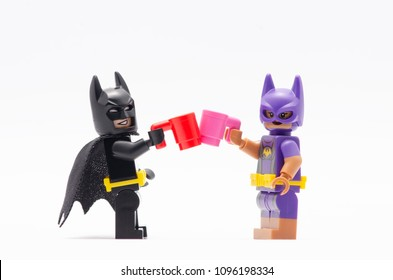 MALAYSIA, may 07, 2018. mini figure of  batman and batgirl having a drink together. Lego minifigures are manufactured by The Lego Group.