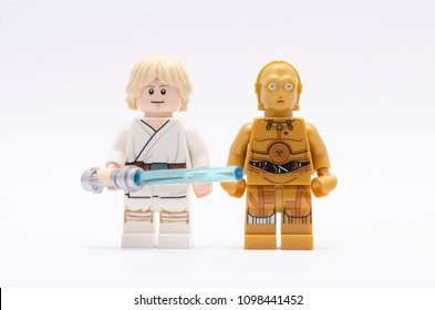 MALAYSIA, may 07, 2018. mini figure of  luke skywalker holding light saber with c3po. Lego minifigures are manufactured by The Lego Group.
