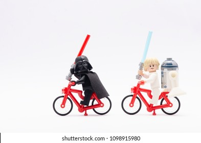 MALAYSIA, may 07, 2018. mini figure of  luke skywalker and r2d2 riding bicycle chasing darth vader. Lego minifigures are manufactured by The Lego Group.