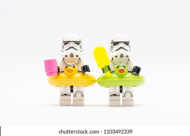 MALAYSIA, may 21, 2018. mini figure of  storm troopers holding ice cream and a cup. wearing floating duck. Lego minifigures are manufactured by The Lego Group.