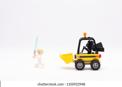 MALAYSIA, may 21, 2018. mini figure of  darth vader driving wheel loader chasing luke skywalker. Lego minifigures are manufactured by The Lego Group.