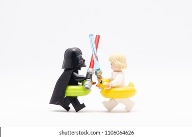 MALAYSIA, may 21, 2018. mini figure of   darth vader and luke skywalker fighting , wearing floating duck. Lego minifigures are manufactured by The Lego Group.