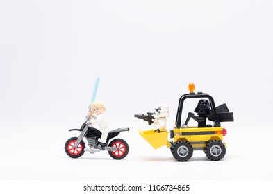 MALAYSIA, may 21, 2018. mini figure of  darth vader driving wheel loader with storm trooper chasing luke skywalker riding motorcycle. Lego minifigures are manufactured by The Lego Group.