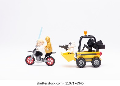 MALAYSIA, may 21, 2018. mini figure of  darth vader driving wheel loader with storm trooper chasing luke skywalker and c3po riding motorcycle. Lego minifigures are manufactured by The Lego Group.