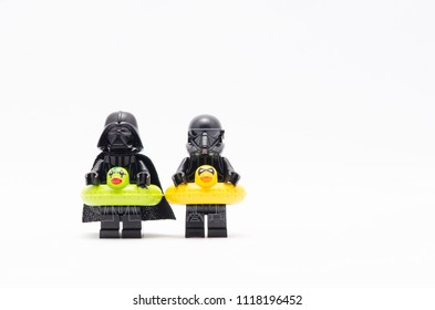MALAYSIA, may 21, 2018. mini figure of darth vader and death trooper wearing a floating duck. Lego minifigures are manufactured by The Lego Group.