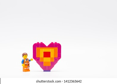 Malaysia, may 31, 2019. lego emmet and piece offering heart shape.  Lego minifigures are manufactured by The Lego.