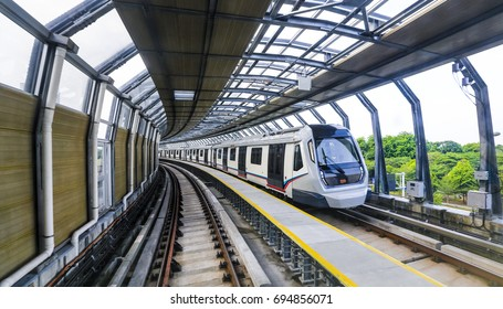 Malaysia MRT (Mass Rapid Transit) train moving fast inside noise barriers. MRT is a transportation for future generation and bring Malaysia as a developed country.