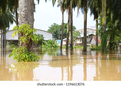 MALAYSIA, MUAR, PANCHOR - FEBRUARY 2011: Natural disaster of flooding takes place in Panchor in 2011. Houses, schools and facilities are submerged in water.
