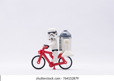 Malaysia, nov 12, 2017. storm trooper with r2d2 riding bicycle.  Lego minifigures are manufactured by The Lego.