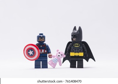 Malaysia, nov 19, 2017. captain america holding pink teddy bear with batman minifigure  .  Lego minifigures are manufactured by The Lego.