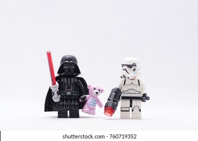 Malaysia, nov 19, 2017. darth vader holding pink teddy bear with storm trooper.  Lego minifigures are manufactured by The Lego.
