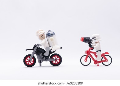 Malaysia, nov 19, 2017. storm trooper riding bicycle chasing rebel army and r2d2 riding dirt bike.  Lego minifigures are manufactured by The Lego.