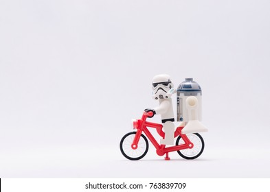 Malaysia, nov 19, 2017. storm trooper riding bicycle with r2d2.  Lego minifigures are manufactured by The Lego.