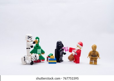 Malaysia, nov 25, 2017. darth vader and santa claus having a toss while storm troopers decorating christmas tree. Lego minifigures are manufactured by The Lego.