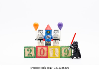 MALAYSIA, okt 27, 2018. lego darth vader with storm troopers holding balloon with firework suit guy standing on number 2019. Lego minifigures are manufactured by The Lego Group.