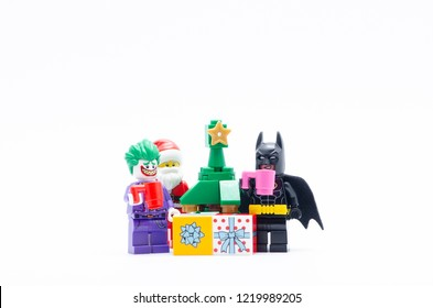 MALAYSIA, okt 27, 2018. lego santa claus with joker and batman have a drink celebrating christmas. Lego minifigures are manufactured by The Lego Group.