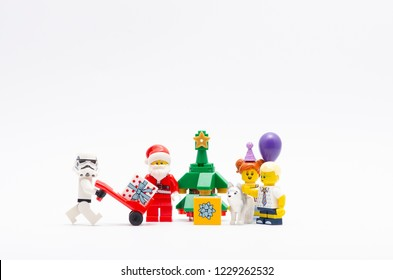 MALAYSIA, okt 27, 2018. lego stormtrooper and santa claus giving gift away to kids. Lego minifigures are manufactured by The Lego Group.