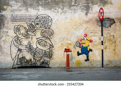 MALAYSIA, PENANG, GEORGETOWN - CIRCA JUL 2014: Two diverse murals painted on the same wall.  One is an informative artistic sign for tourist.  The other is a minion from the movie, Despicable Me.