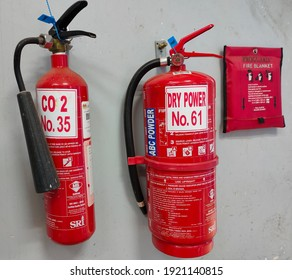Malaysia, Perak, 18 February 2021: Selective focus.Two types of fire extinguishers with fire blanket in a laboratory.Shot were noise and artifacts.