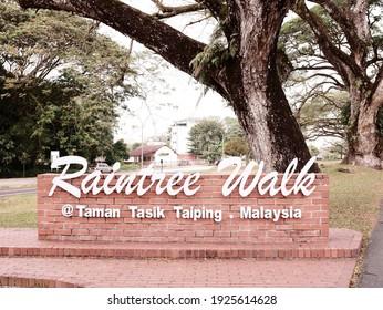 """Malaysia, Perak, 20 February 2021 : The alphabet """"Raintree Walk"""" is displayed at Taman Tasik Taiping in Malaysia."""