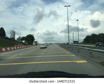 Malaysia, Putrajaya - 2 July 2019 : yellow line on the top or Yellow Tranverse Bar as a reminder to the vehicle to slow the vehicle gradually.