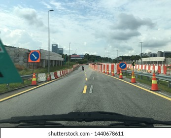 Malaysia, Putrajaya - 2 July 2019:the highway is over repair. Roadside roadblocks for safe distance directions for road users.