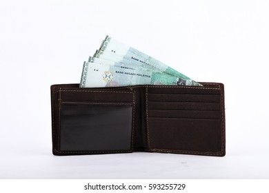 Malaysia Ringgit bank note in a wallet isolated on  white background. For business and financial concept