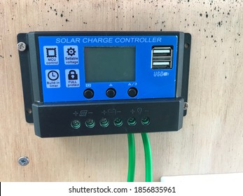 Malaysia, Sabah, 19.11.2020 : View of monitor indicator solar charge controller using wiring and UBS plug. WHC Solar brand.