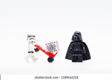 MALAYSIA, sept 2, 2018. lego storm trooper pushing trolley with gift box while darth vader watching. Lego minifigures are manufactured by The Lego Group.