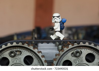 malaysia, sept 23, 2017. storm trooper walking on car timing belt. minifigures are manufactured by The Lego Group.
