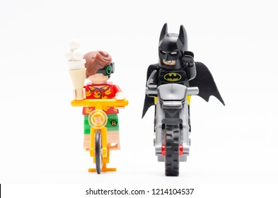 MALAYSIA, sept 30, 2018. lego batman with robin riding bicycle with radio at his back and holding a ice cream. Lego minifigures are manufactured by The Lego Group.