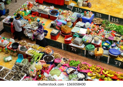 Kelantan,  Malaysia-FEBRUARY 2014: Local buying vegetables at Siti Khadijah Market,  a famous indoor market for tourist and locals located in the city of Kota Bharu.
