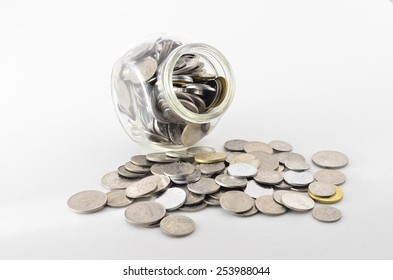 Malaysian Coin in glass container. Shoot over white background. Focus on the important part. Shallow depth of field.