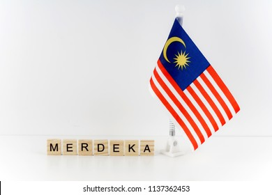 """Malaysian flag or also known as """"Jalur Gemilang"""" with alphabet wording """"Merdeka"""". """"Merdeka"""" means independent day in english"""