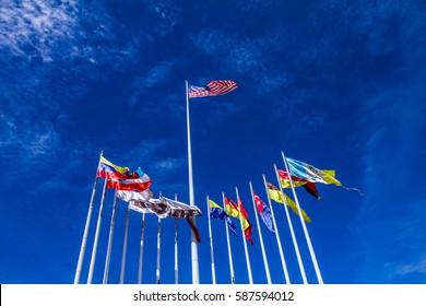Malaysian flag on a pole with blue sky