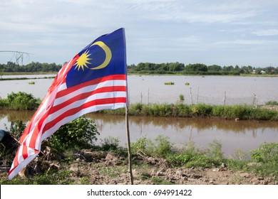 Malaysian flag waving.