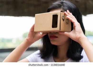 Malaysian Girl Wearing VR Cardboard Helmet
