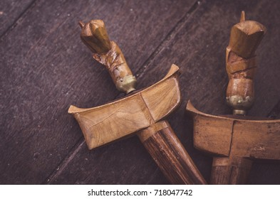 malaysian heritage, antique malay dagger or Keris on wooden floor.low light shot, image may contain grain