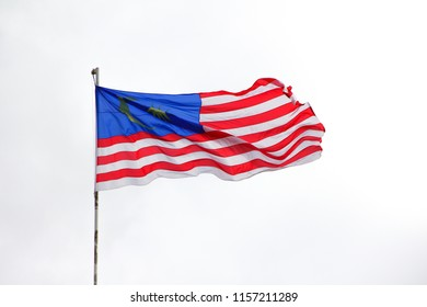 Malaysian National flag waving over white background