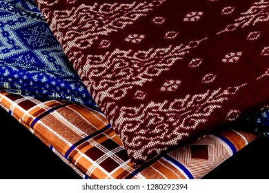 Malaysian sarongs isolated on a black background