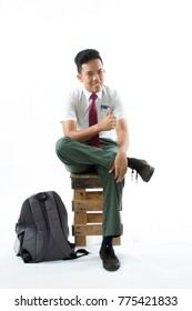 Malaysian secondary school boy with back pack  isolated on white background.suitable for back to school theme