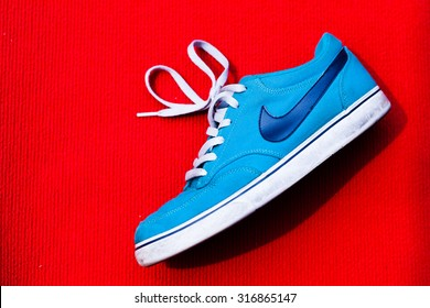 MALAYSIAN - SEPTEMBER 12 , 2015 : Nike shoes with red background and this  photo in